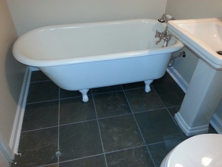 Claw tub and porcelain tile